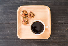 Black coffee with cookies Stock Image