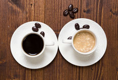 Black coffee and cream coffee Royalty Free Stock Image