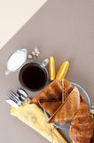 Black coffee, cream, fresh croissants and toasts are served on a Royalty Free Stock Photo