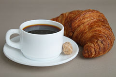 Black coffee and croissant. Breakfast, cup of coffee and croissant Royalty Free Stock Photography