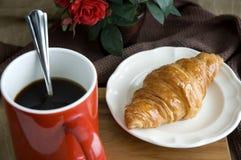 Black coffee with croissant Stock Photos
