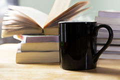 Black coffee cup and book pile in the morning Stock Photo