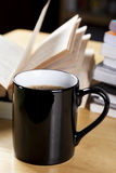 Black coffee cup and book pile Stock Photo