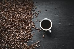 Black coffee in the cup And coffee beans background On the blackboard.  stock images