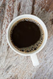 Black coffee. Coffee cup on dark wooden table. Top view Stock Photos