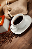 Black coffee - cup and grains Royalty Free Stock Image