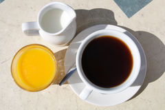 Black coffee cup milk jar orange juice Stock Photo