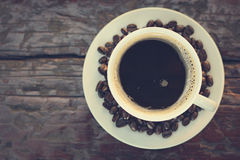 Black coffee in the cup on old wood table (top view) Stock Photo