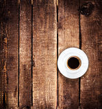 Black Coffee cup on old wooden table with copyspace,  top view. Royalty Free Stock Photography