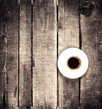 Black Coffee cup on old wooden table with copyspace,  top view. Stock Image
