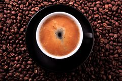 Black coffee cup with roasted beans background top view Royalty Free Stock Photos