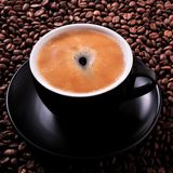 Black coffee cup roasted beans background square closeup Royalty Free Stock Photo