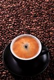 Black coffee cup with roasted beans background vertical Royalty Free Stock Photography