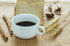 Black coffee  cup. Black coffee cup on sackcloth Stock Photo