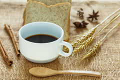 Black coffee cup. On sackcloth Stock Images