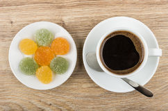 Black coffee in cup, spoon and marmalade in saucer Stock Photography