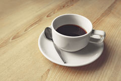 Black coffee cup on table Stock Photo