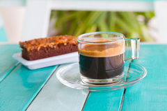 Black coffee cup on white blue table Royalty Free Stock Photos