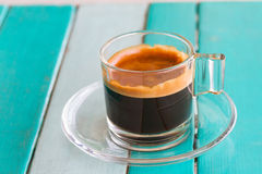 Black coffee cup on white blue table Royalty Free Stock Photography