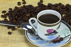 Black coffee. Cup of black coffee on wood background Royalty Free Stock Photography
