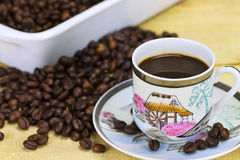 Black coffee. Cup of black coffee on wood background Stock Photos