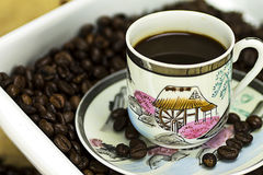 Black coffee. Cup of black coffee on wood background Royalty Free Stock Photo