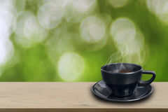 Black coffee cup on wooden Stock Image