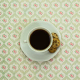 Black coffee with cupcakes on vintage tablecloth Royalty Free Stock Images
