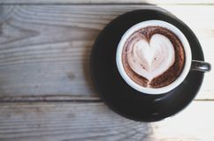 Black coffee cups placed on the table in the morning. stock photography