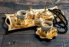 Black coffee cups rosary beads Ramadan kareem Stock Photos