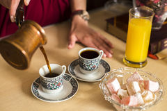 Black coffee in cups and Turkish delight Royalty Free Stock Image