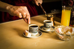 Black coffee in cups and Turkish delight Royalty Free Stock Images