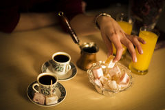 Black coffee in cups and Turkish delight Royalty Free Stock Photography