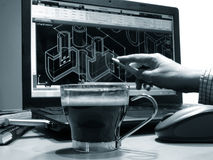 Black coffee and designer. Cup with black coffee at designer workplace monochrome image Royalty Free Stock Photography
