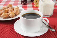Black coffee with donut holes Royalty Free Stock Image