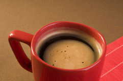 Black coffee drink  in a red cup Stock Photography