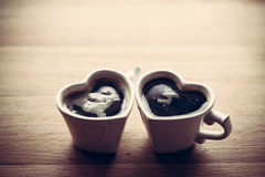Black coffee, espresso in two heart shaped cups.. Love, Valentine's Day, vintage stock image