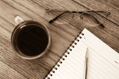 Black coffee, eye glasses and notebook. Royalty Free Stock Photo