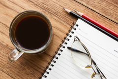 Black coffee, eye glasses and notebook. Royalty Free Stock Photography