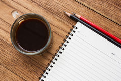 Black coffee, eye glasses and notebook. Stock Image