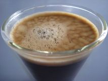 Black Coffee served in a cafe glass Royalty Free Stock Photo