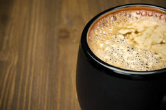 Black coffee with froth close-up and space for text Stock Images