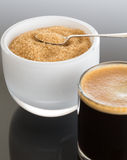Black coffee and froth in glass mug with sugar Stock Photography