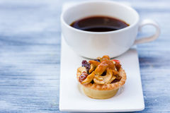 Black coffee and Fruit Tart. On wooden table Royalty Free Stock Image