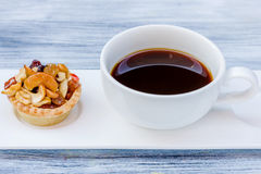 Black coffee and Fruit Tart. On wooden table Royalty Free Stock Photo