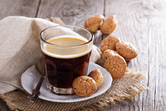 Black coffee in a glass with almond cookies Stock Image