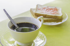 Black coffee in a glass with bread. Black coffee in a glass with bread on the table Royalty Free Stock Photography