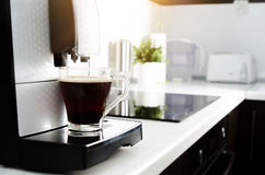 Black coffee in glass from coffee maker machine Royalty Free Stock Image