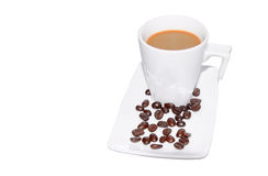 Black Coffee in Glass cup and beans on a white background. Black Coffee in Glass cup and beans on a white background. (with clippi Stock Photos