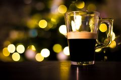 Black coffee in glass cup. With chrismas lights Stock Photography